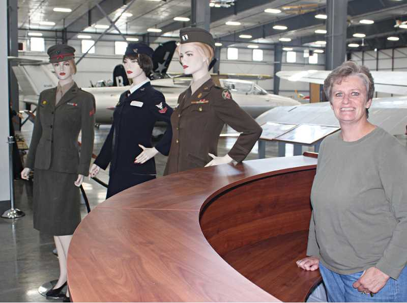 Photo Credit: HOLLY M. GILL - Michelle Forster, assistant manager at the Erickson Aircraft Collection, has helped set up the new facility, which opens on Friday.