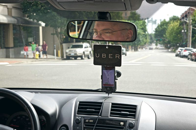 Photo Credit: TRIBUNE PHOTO: JAIME VALDEZ - Eric Hansen drives around downtown Vancouver, Wash., on a Friday afternoon to demonstrate the experience he provides to riders as an UberX driver.