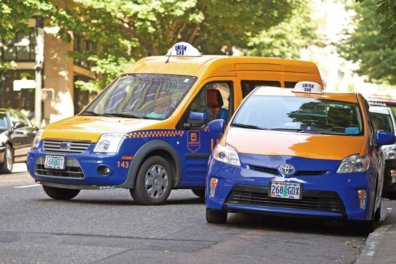 Photo Credit: TRIBUNE PHOTO: JAIME VALDEZ - A Union Cab leaving the downtown Hilton Portland and Executive Tower is one of dozens of taxis that must have a city license to operate. Portland officials have moved slowly on allowing ridesharing programs because of city licensing requirements.