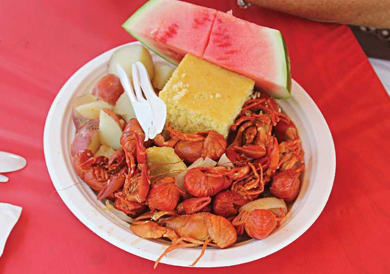 Photo Credit: JEFF WILSON - The Crawdad Festival featured plates stacked with crawdads, potatoes, cornbread and watermelon.