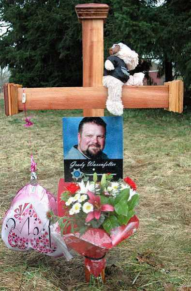 Photo Credit: TRIBUNE FILE PHOTO - A highway memorial honors Grady Waxenfelter, a Clackamas County weighmaster who was killed near the intersection of Highway 224 and Amisigger Road of Feb. 6.