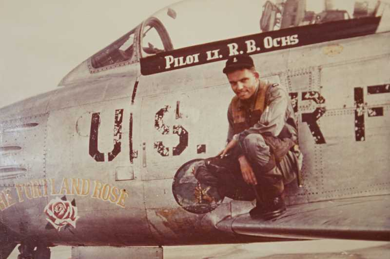 Photo Credit: OCHS FAMILY PHOTO - Young Ron Ochs with the Air Force F-86F jet he flew during the Korean War.