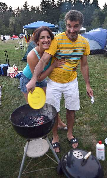 Photo Credit: TIDINGS PHOTO: VERN UYETAKE - Sasan and Mona Homayouni of Iran enjoy the camping experience as guests of friends who live in West Linn.