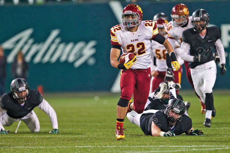 Photo Credit: TRIBUNE FILE PHOTO: JAIME VALDEZ - Cameron Scarlett of Central Catholic breaks into the clear for one of his five touchdowns in last years 83-49 state semifinals win against Tigard.