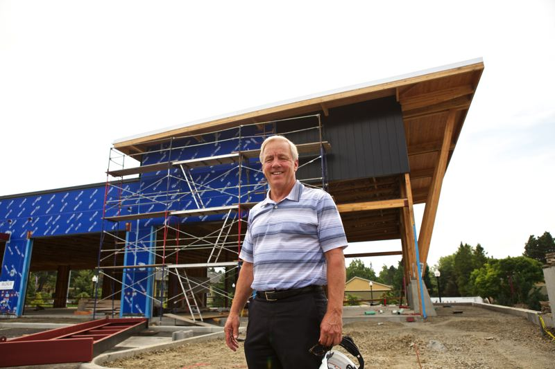Photo Credit: TIMES PHOTO: JAIME VALDEZ - Gramor Development CEO Barry Cain stands in front of where Ava Roasteria will be located at the Timberland Town Center development on Northwest Barnes Road.