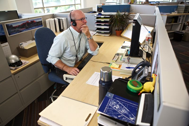 Photo Credit: TIMES PHOTO: JAIME VALDEZ - City of Beaverton Associate Planner Jeff Salvon works on a project in the community development department on the fourth floor of the Beaverton Building at The Round, the city of Beaverton's new administrative center.