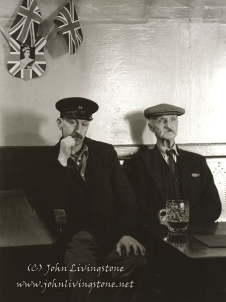 Photo Credit: CONTRIBUTED PHOTO: JOHN LIVINGSTONE - 'Coronation Breakfast,' a picture John Livingstone took of two men watching Her Majesty Queen Elizabeth IIs coronation in June 1953, brought him royal recognition this past spring with a complimentary letter directly from Buckingham Palace.