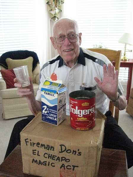 GAZETTE PHOTO: RAY PITZ - Donald Anderson displays props from Fireman Don's El Cheapo Magic Act, which he brought out to entertain children when he worked for the former Tualatin Rural Fire Protection District.