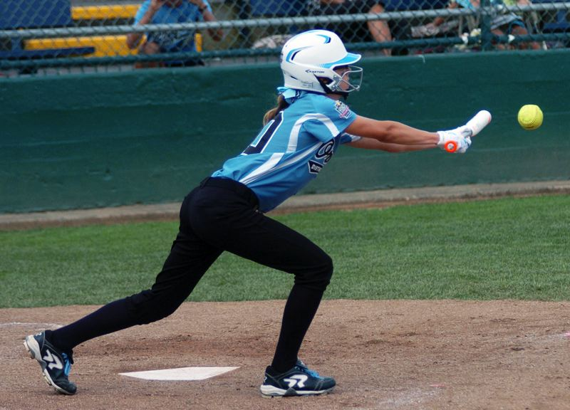 Photo Credit: DAN BROOD - FUNDAMENTALS -- Tigard/TC's Leah Sandoz puts down a bunt for a single in the team's game with Canada at the Little League Softball World Series.