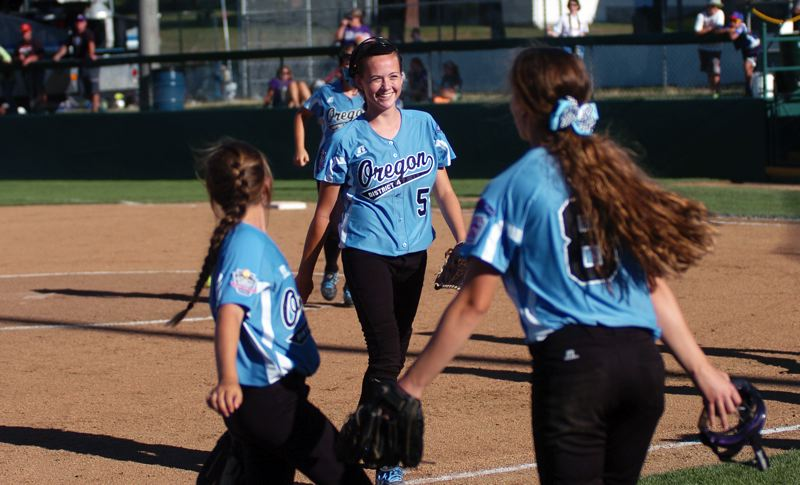 Photo Credit: DAN BROOD - Tigard/TC pitcher Elizabeth Hillier (5) is all smiles after getting the save in the victory over Prague.