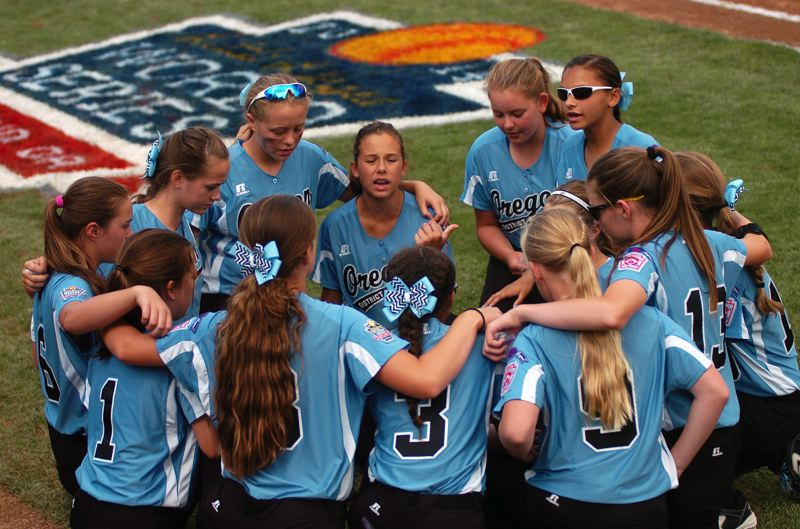 Photo Credit: DAN BROOD - The Tigard/Tualatin City team gathers prior playing Canada in the Little League Softball World Series fifth-place game.