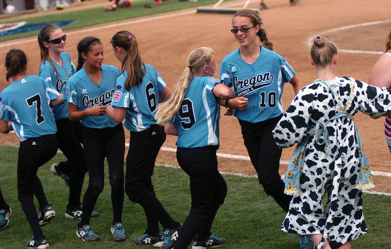 Photo Credit: DAN BROOD - It's chicken dance time between innings of the fifth-place game at the Little League Softball World Series.