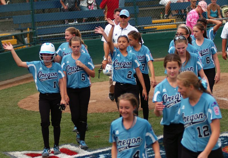 Photo Credit: DAN BROOD - Tigard/TC players waive to their fans after finishing play at the 2014 Little League Softball World Series.