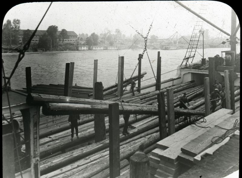 Photo Credit: COURTESY OF THE COLUMBIA COUNTY MUSEUM ASSOCIATION - 'St. Helens: America in Images' will feature potentially hundreds of historical photographs from the Columbia County Museum Association's archives and beyond. This photo is believed to show the old St. Helens Creosote site in the foreground and the shipyards of Sauvie Island in the background.