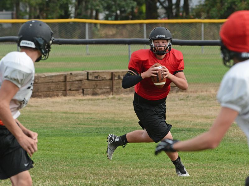 Photo Credit: JOHN WILLIAM HOWARD - Listed at 6-foot-1, 225 pounds, Levi Norton is a far different quarterback than any of the signal callers seen out of St. Helens in the several seasons. Many quarterbacks also see the field as receivers and defensive backs, but not Norton - He was a linebacker and right guard in youth football.