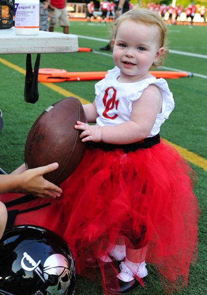Photo Credit: JOHN LARIVIERE - Rylee Ferro was the honorary team captain for Oregon City for this years Battle for the Bridge alumni football game. Ferro was diagnosed with Cystic Fibrosis just days after her birth in March of 2013. In four years, Battle for the Bridge has raised close to $80,000 for the Cystic Fibrosis Foundation, as that organization strives to find a cure.