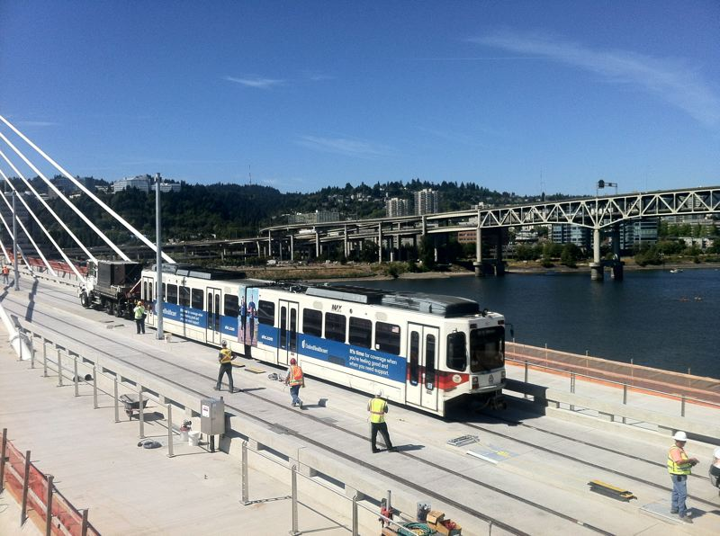 Photo Credit: TRIBUNE PHOTO JAIME VALDEZ - A MAX train went over the Tilikum Crossing for the first time Monday as part of a safety test. This picture was taken from the Portland Opera building on the east bank of the Willamette River.