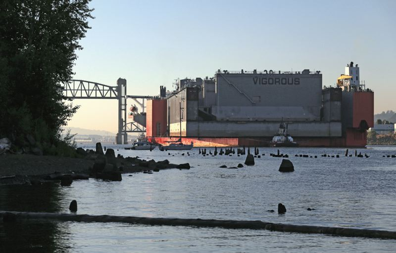 Photo Credit: TRIBUNE PHOTO: JONATHAN HOUSE - The Vigorous, the worlds largest floating dry dock, is carried under the St. Johns Bridge Monday morning on the way to Vigor Industrials shipyard at Swan Island.
