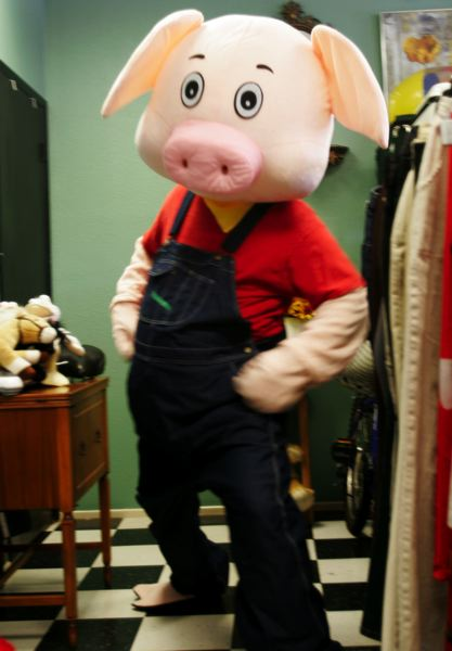 Photo Credit: OUTLOOK PHOTO: JIM CLARK - The stores mascot, Richie the Pig (aka Josh), is meant to symbolize a piggy bank and the savings shoppers can acquire if they use a piggy bank.
