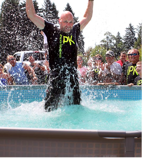 Photo Credit: OUTLOOK PHOTO: ANNE ENDICOTT - Gresham resident and Practice Kindness spokesperson Dale Lovett was the first to take the plunge into a swimming pool filled with cold water and 4,100 pounds of ice.