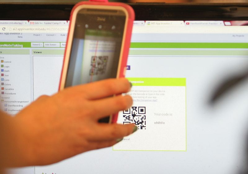 Photo Credit: OUTLOOK PHOTO: JIM CLARK - A student uses a QR scanner to transfer an app she and her partner wrote from their computer to their phone.