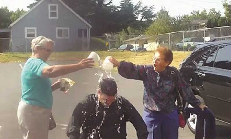 Photo Credit: COURTESY OF DAVE MILLER - Members of Woodburn Immanuel Lutheran Church dump water over Pastor Dave Miller's head during a fundraiser for ALS.