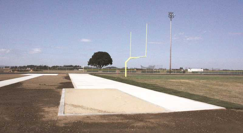 Photo Credit: LINDSAY KEEFER - Construction on Kennedy High School's track and field will be finished in time for the first home football game Sept. 12, during Oktoberfest. The next day, it will be used as the finish line for the Oregon Mara-thon.