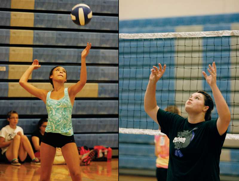 Photo Credit: PHIL HAWKINS - Junior outside hitter Kanisha Ott-Parker (left) and senior middle blocker Sierra Shepherd (right) both earned honorable mention nominations for the Woodburn volleyball team last season and will give the Bulldogs much needed stability as the team transitions from its senior-heavy team in 2013.