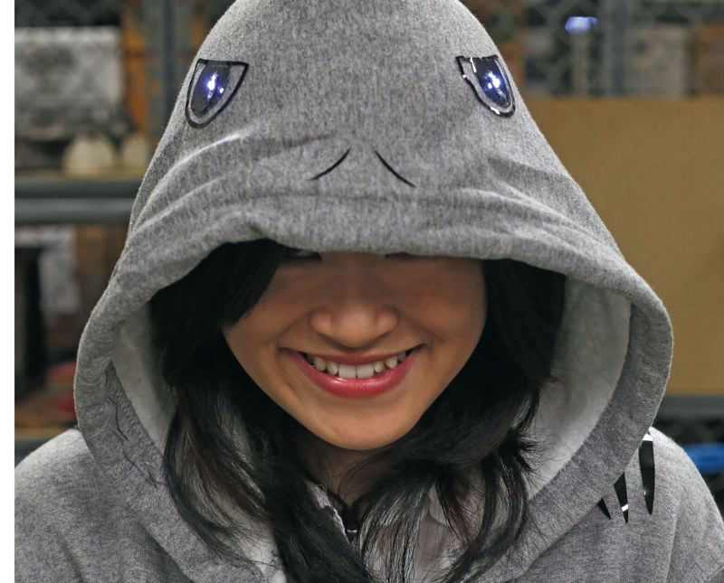 Madeline Pitoby shows off her Shark Week never ends hoody with built in lights and sounds