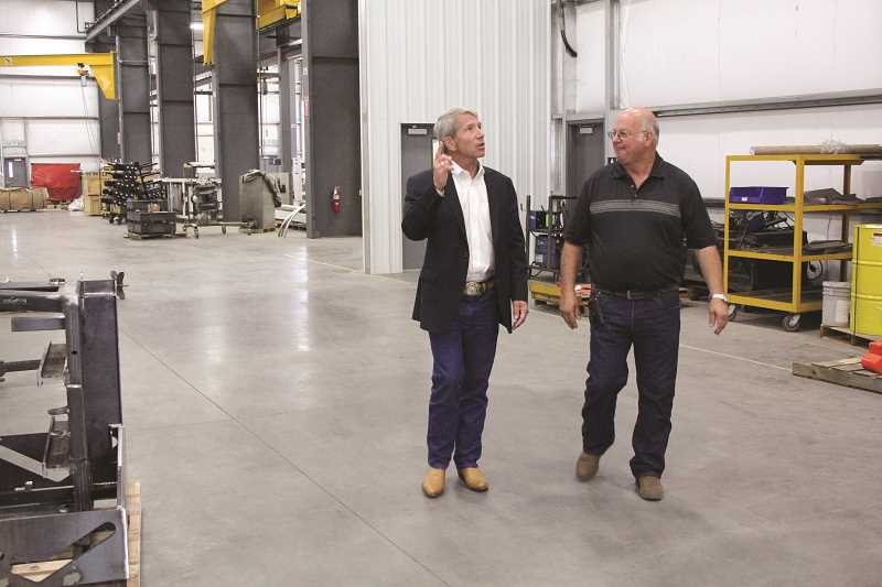 Photo Credit: TYLER FRANCKE | WOODBURN INDEPENDENT - Kurt Schrader, Democratic representative for Oregon's 5th Congressional District, talks with GK Machine Inc. President Gary Grossen last week during a tour of the Donald company's recent expansion.