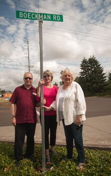 Photo Credit: SPOKESMAN PHOTO: JOSH KULLA - The Boeckman siblings (L-R Steven, Candace and Judi) gather at the crossroads of Boeckman and Stafford Road, the same spot their father Elmer posed for a photo for the Spokesman some 30 years earlier.