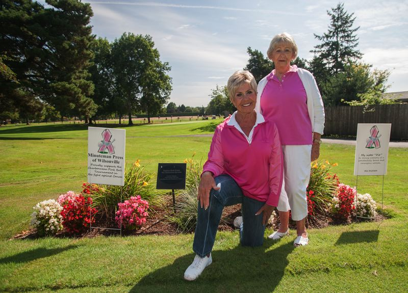 Photo Credit: SPOKESMAN PHOTO: JOSH KULLA - Charbonneau Country Club hosts the Niners womens nine-hole golf group. The Niners, including tournament committee members Jane King and Sheila Barton, left, put on the Pink Ball Tournament each year. They raise money through a host of means, including the sale of tee signs such as those on either side of the women.