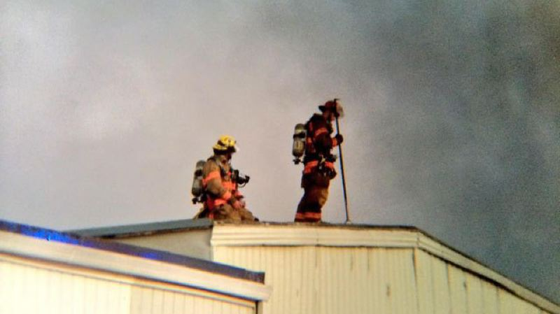 Photo Credit: KOIN 6 NEWS - An Oregon City fire burned through multiple businesses within a single building Wednesday morning.