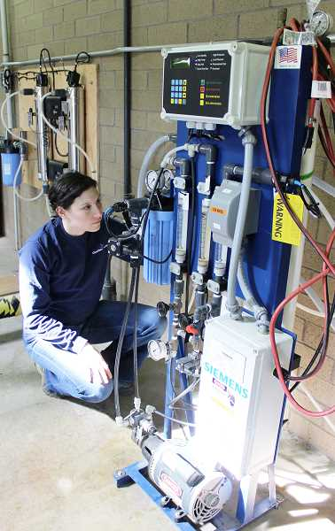 Photo Credit: COURTESY PHOTO: CLEAN WATER SERVICES - Dr. Adrienne Menniti of Clean Water Services operates the high-purity water system at CWS Forest Grove treatment facility, where its research and development team conducts experiments. The system uses several purification technologies, including ultrafiltration, reverse osmosis, advanced oxidation and disinfection to create high-purity water, said CWS spokesman Mark Jockers.