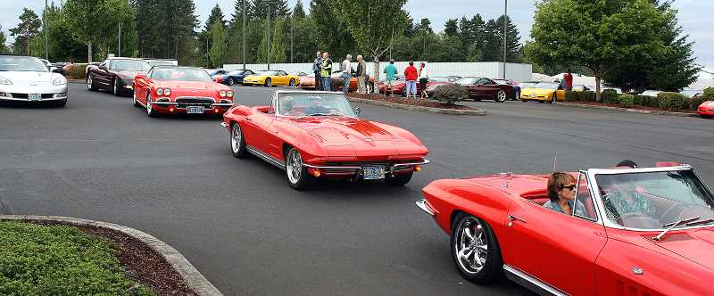 Photo Credit: POST PHOTO: LAURA KNUDSON  - The first of the corvettes rolled out in pursuit of Bowling Green, Kentucky where caravan participants celebrated the 20th anniversary of the National Corvette Museum.