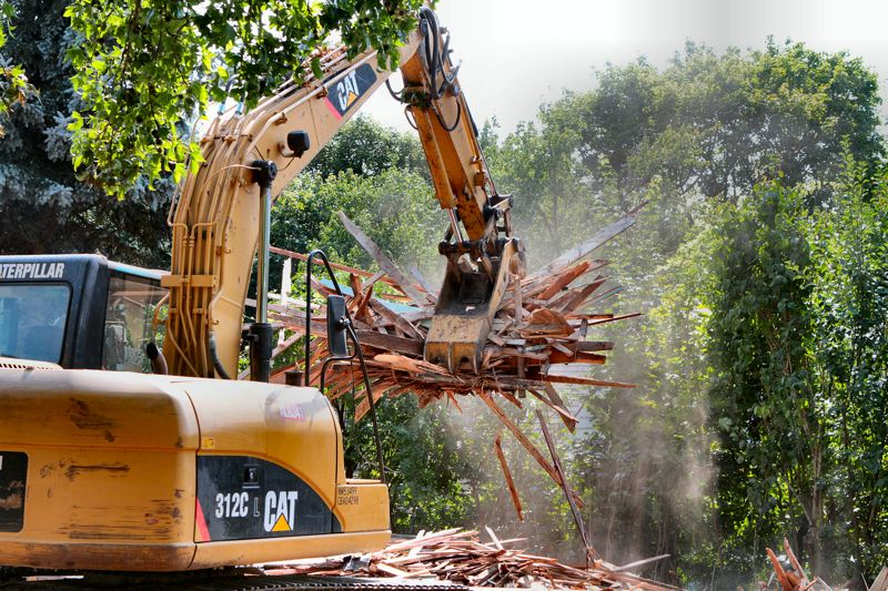 Photo Credit: DAVID F. ASHTON - The demolition excavator made quick work of the embattled Eastmoreland house on Rural Street; at the end of the day about all that was left was kindling.
