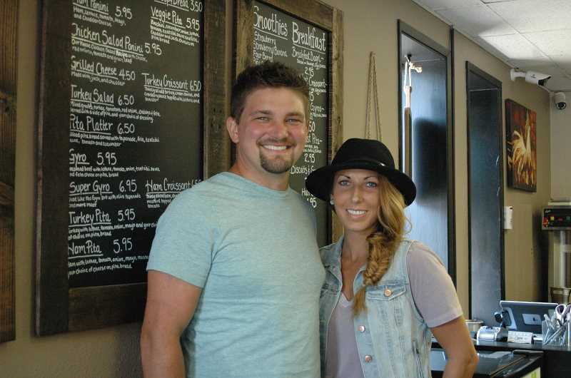 Photo Credit: ESTACADA NEWS PHOTO: ISABEL GAUTSCHI - Andrew and Courtney Young are the new owners of The Grind Coffee House.