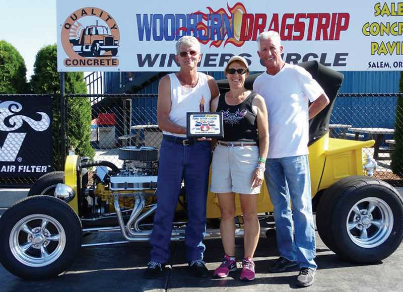 Photo Credit: COURTESY OF WOODBURN DRAGSTRIP - Sportsman winner Devon Hilton (left) holds aloft his trophy with wife Miriam Hilton, and Leo Hillyer, founder of Hillyers Mid City Ford and sponsor of the weekends event at the Woodburn Dragstrip.