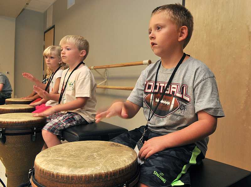 Photo Credit: STAFF PHOTOS:  - Talon Denison drums to the beat in a recording class during a Youth Music Project summer camp.