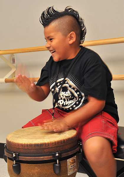 Anthony Maderia, 6, has fun drumming in a recording class.