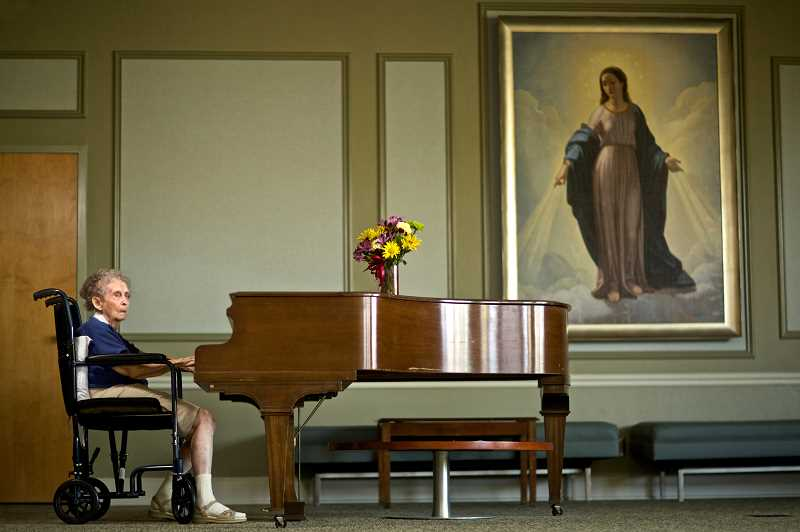 Photo Credit: TIMES PHOTO: JAIME VALDEZ - Bettye Lowery, 86, plays a piano at Maryville Nursing Home, in Beaverton, where she has lived for the past two years. The poet has been writing gospel music for decades, but had never heard her music played before until last week at a Tigard-area church.