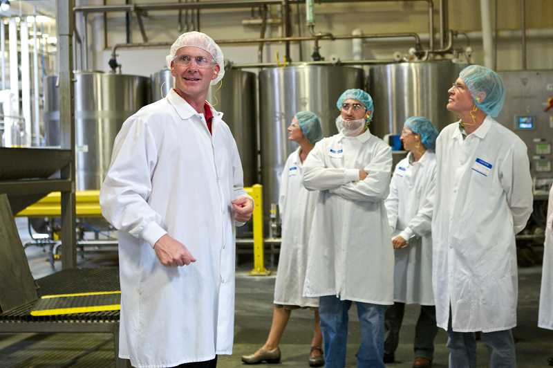 Photo Credit: TIMES PHOTO: JAIME VALDEZ - Erik Gottschalk, vice president of operations at Pacific Natural Foods, guides a tour of the companys Tualatin Plant where soy beans are ground up and blending stations are located.