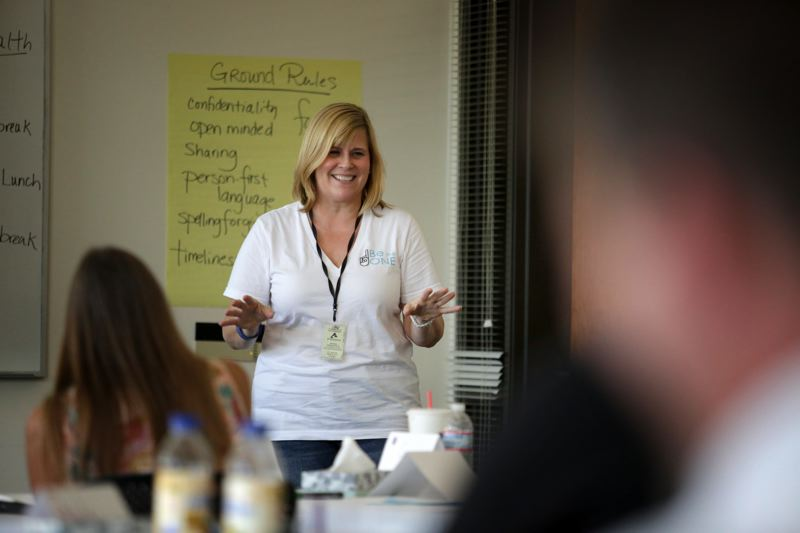 Photo Credit: JONATHAN HOUSE - Youth Mental Health First Aid instructor Karen Carlin teaches a class in the method to some of the 500 people Clackamas County hopes to train in the next year.
