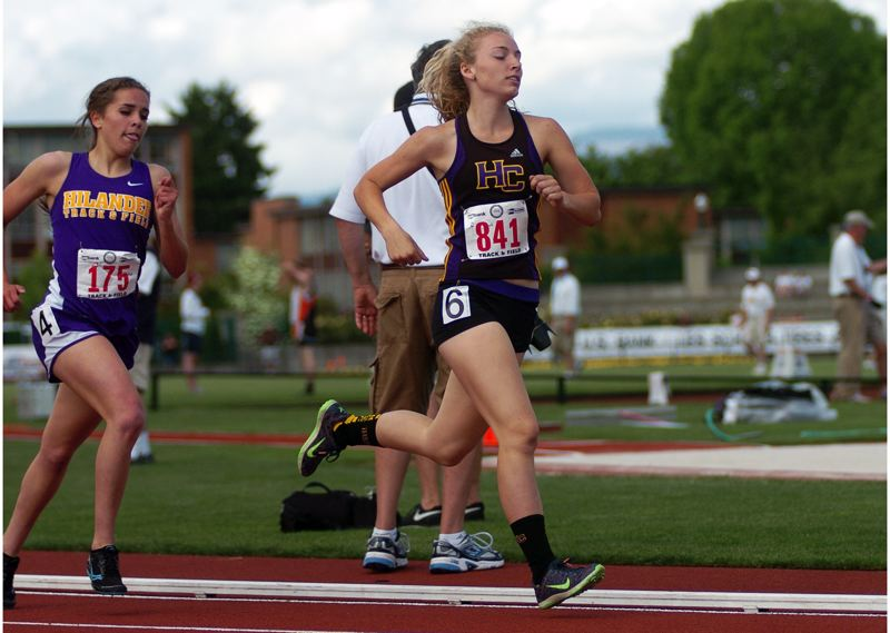 Photo Credit: DAN BROOD - PICKING UP THE PACE -- Senior Hannah Cesario, shown here at the Class 3A state track and field championships, will lead the way for the Hawks.