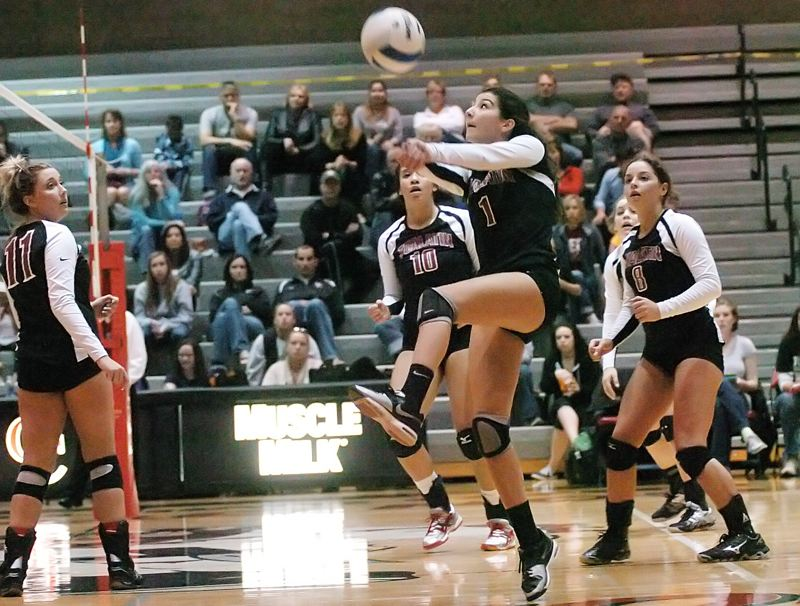 Photo Credit: DAN BROOD - FOR THE DEFENSE -- Tualatin High School junior Sara Fanger (1), shown here in a postseason match from last year, moves to play the libero spot for the Timberwolves this year.