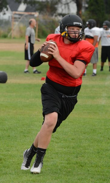 Photo Credit: JOHN WILLIAM HOWARD - Sophomore Levi Norton will take over the quarterback duties for St. Helens. The coaches say he's got a strong arm, and is more than willing to lay a hit on would-be tacklers.
