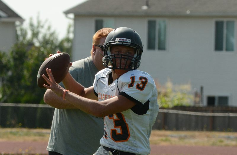 Photo Credit: JOHN WILLIAM HOWARD - Starting quarterback Joey Krupsky is speedy and difficult to catch, giving Scappoose a new wrinkle in their offense.