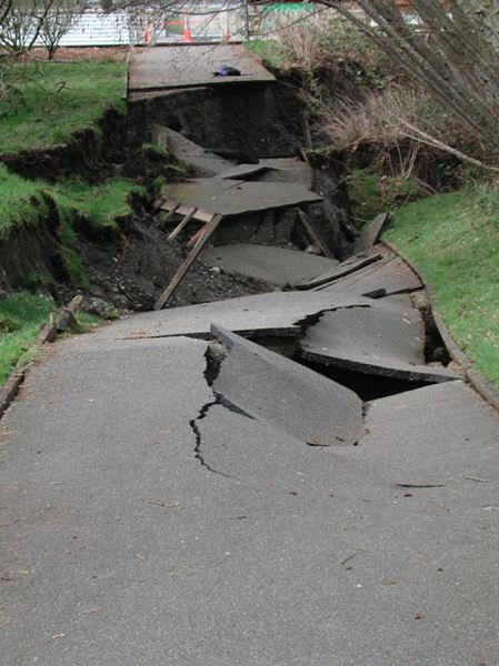 Photo Credit: COURTESY OF THE WASHINGTON STATE DEPARTMENT OF NATURAL RESOURCES - A collapsed walking path in Olympia, Wash., showing the extensive damage caused by the 2001 Nisqually earthquake. One fatality and hundreds of injuries were attributed to the magnitude 6.8 temblor, which was felt throughout most of Washington, northwest Oregon and southwest British Columbia.