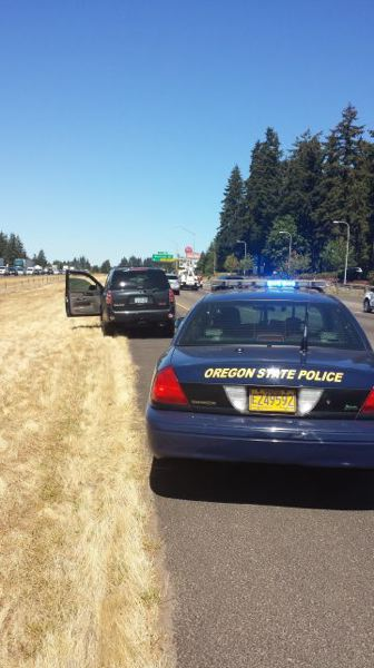 Photo Credit: PHOTO COURTESY OF OREGON STATE POLICE - Police are shown here at the scene where Logan Hansen, 29, of Medford, allegedly abandoned a stolen SUV and fled on foot. He was later arrested by Wilsonville Police and faces several criminal charges.