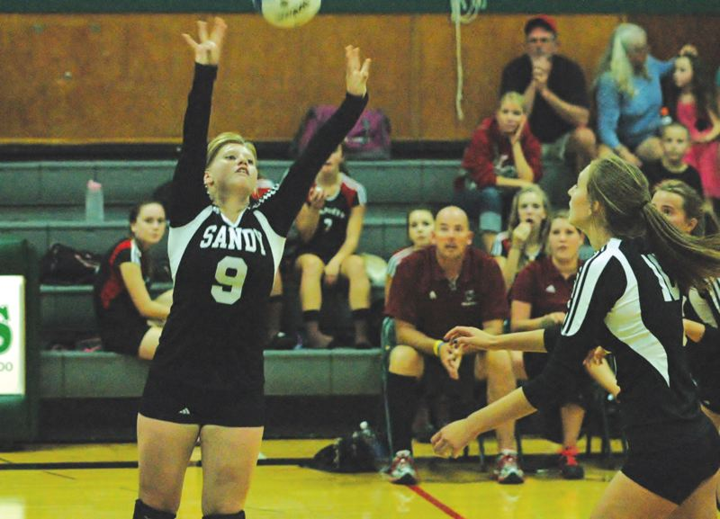 Photo Credit: SANDY POST: PARKER LEE - Sandys Ashley Laughlin sets the ball to the outside during a match last season.
